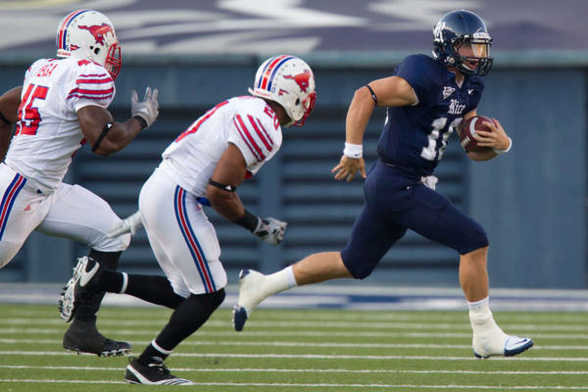 Rice quarterback Taylor McHargue, right, was knocked out of Saturday's game after taking a late hit from SMU linebackert Ja'Gared Davis. The Owls' offense was slow to get going after that, as Rice fell 42-31 at Rice Stadium.