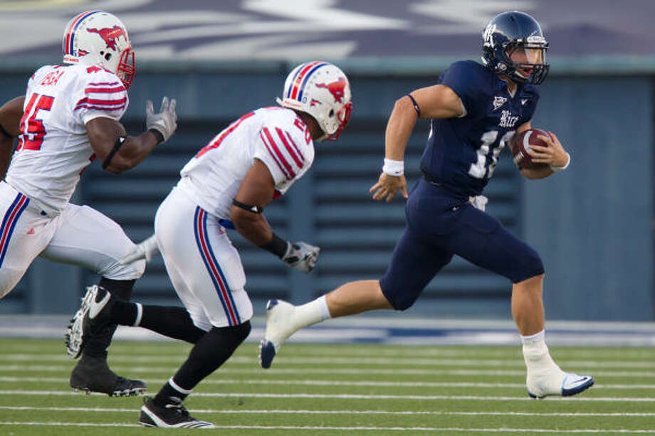 Rice quarterback Taylor McHargue, right, was knocked out of Saturday's game after taking a late hit from SMU linebackert Ja'Gared Davis. The Owls' offense was slow to get going after that, as Rice fell 42-31 at Rice Stadium. Photo: Smiley N. Pool, Chronicle