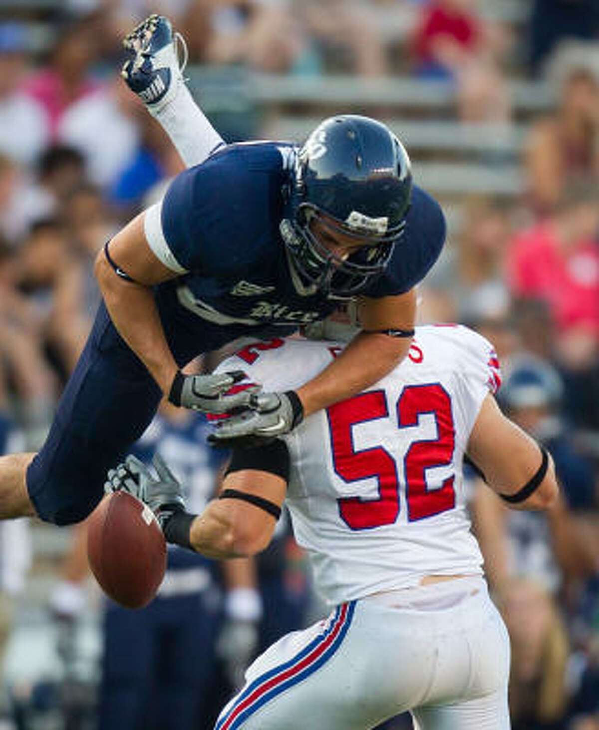 Rice tight end Luke Willson can't hold onto a pass while being hit by SMU linebacker Pete Fleps during the first half.