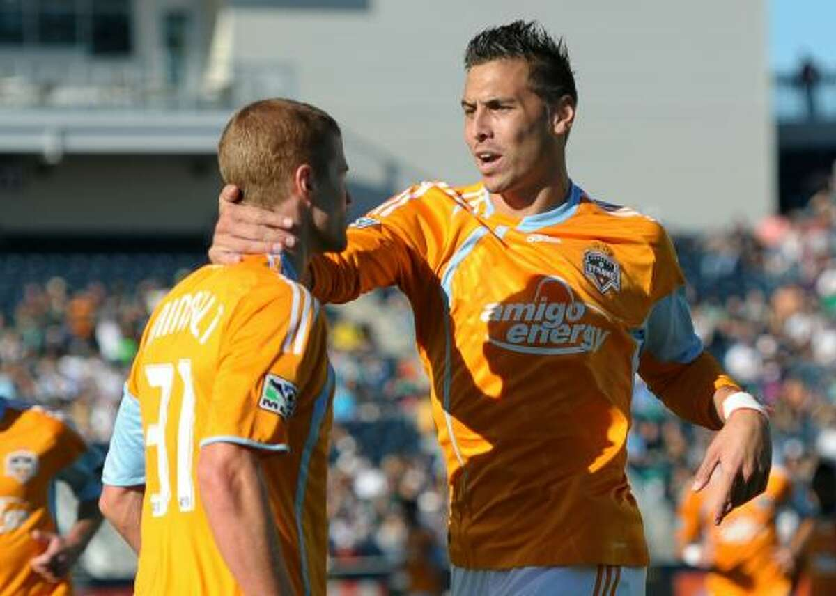 Geoff Cameron congratulates teammate Andrew Hainault (31) on his first-half goal.