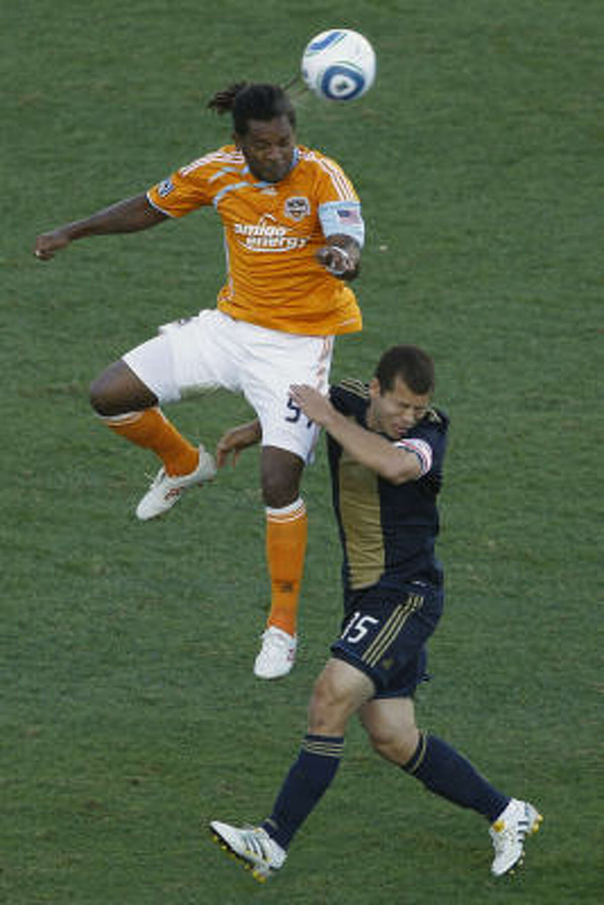 The Dynamo's Adrian Serioux, left, and Philadelphia's Alejandro Moreno battle for a header in the first half.