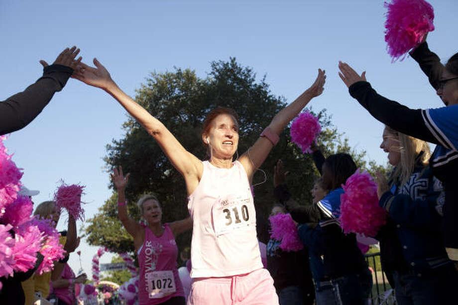 Ingrid Van Houten crosses the survivors finish line. Photo: Eric Kayne, For The Chronicle