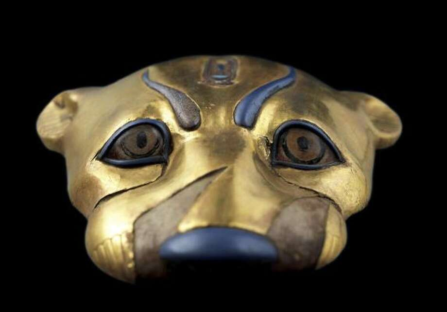 "This leopard's face decorated a robe of the type worn by the sem-priests, who performed an important funerary ritual called the Opening of the Mouth. The officiant, dressed in a leopard-skin robe, magically ""opened"" the eyes, nose, ears and mouth of the mummy, so that in the next world its owner could breathe, use his senses, and answer questions posed by the deities who would judge him before Osiris. After this ritaul, the deceased was ready for burial. Tutankhamun's successor, Ay, is shown in the young pharaoh's tomb in the leopard skin robe of a sem-priest, performing the Opening of the Mouth on Tutankhamun's mummy. A similar leopard-head ornament was found in the tomb, together with the remains of a linen robe that had silver stars and claws of silver attached. -Zahi Hawass Photo: ©2008 Sandro Vannini"