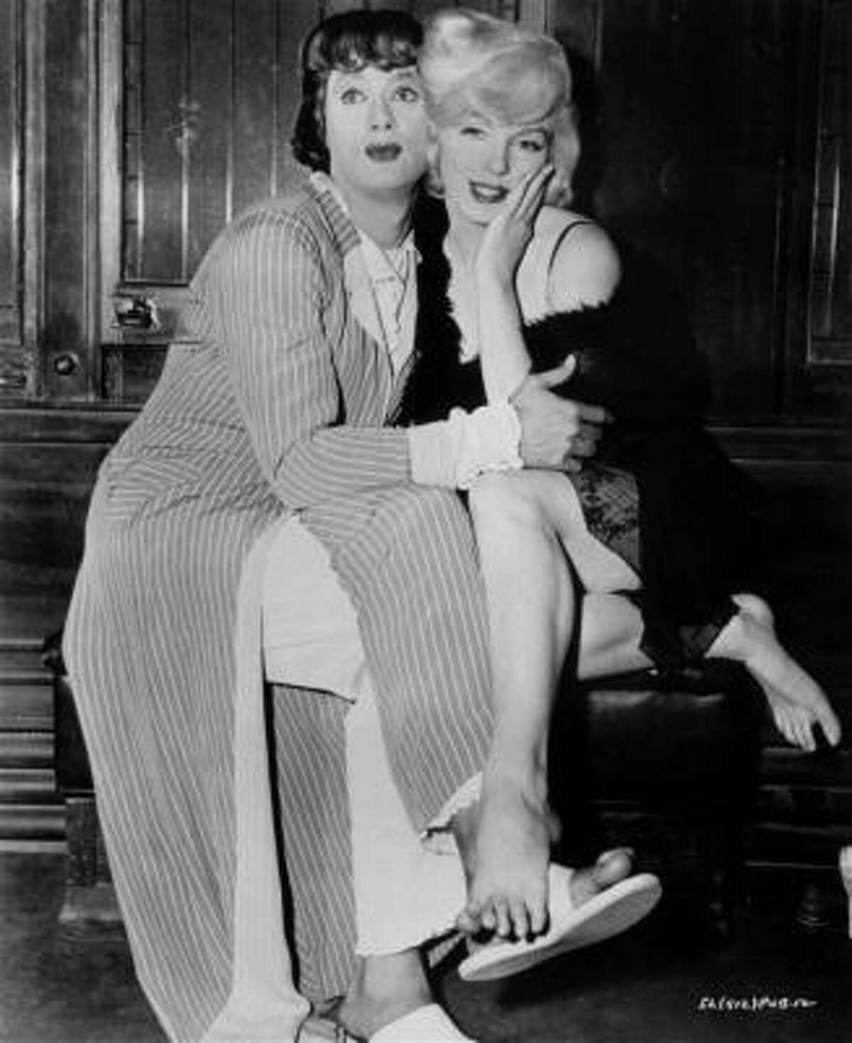 Tony Curtis and Marilyn Monroe in 1959 on the set of the milestone comedy,