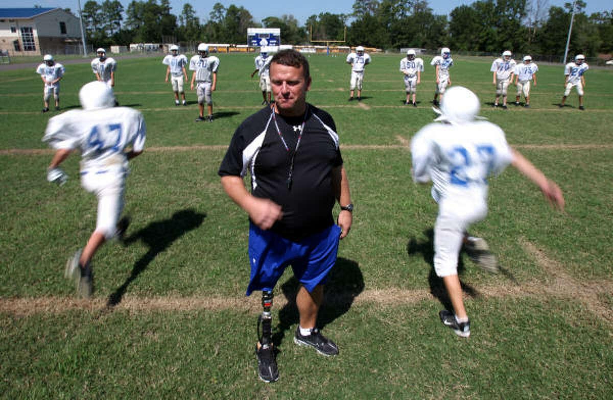 Nathan Potts surveys his team as its runs through warmup drills.