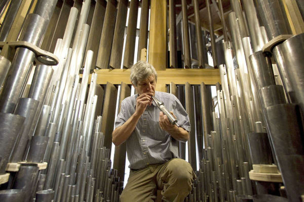 Pasi Organ Builders' Martin Pasi voices a pipe inside the new pipe organ at the Co-Cathedral in Houston.