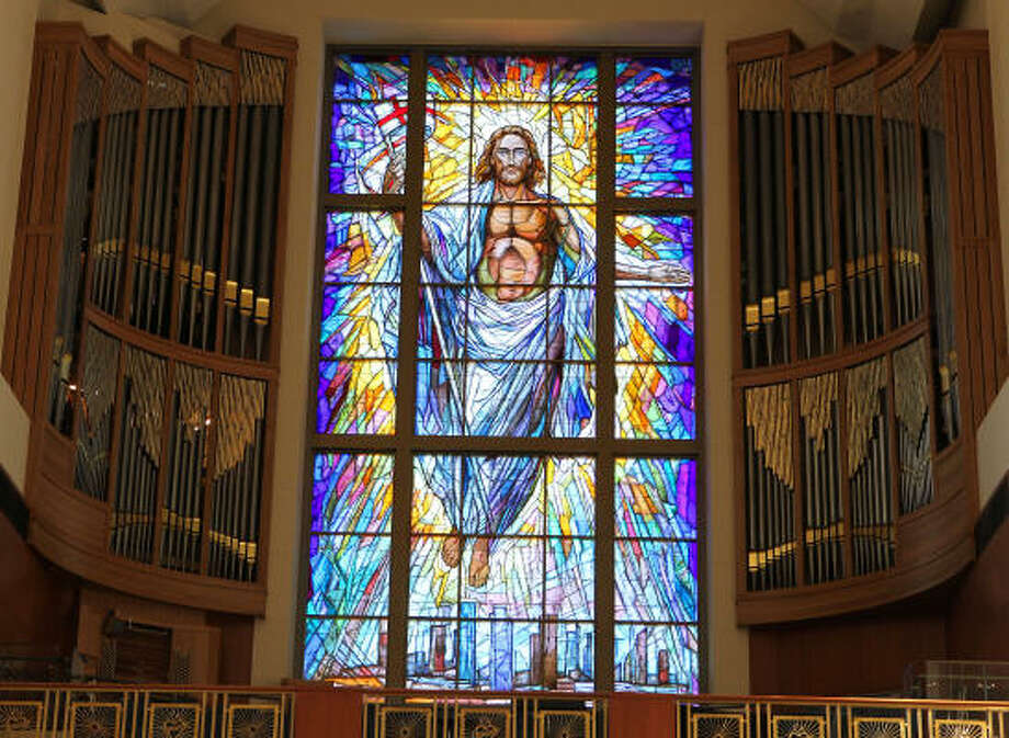 The new pipe organ at the Co-Cathedral surrounds the massive Resurrection Window. The 40-foot-tall, 20-foog-wide stained-glass window is on the facade of the Co-Cathedral. Photo: James Nielsen, Chronicle