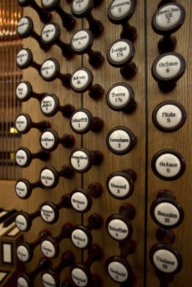 Buttons or handles known as stops control the quality of sound on the new pipe organ at the Co-Cathedral. Photo: James Nielsen, Chronicle