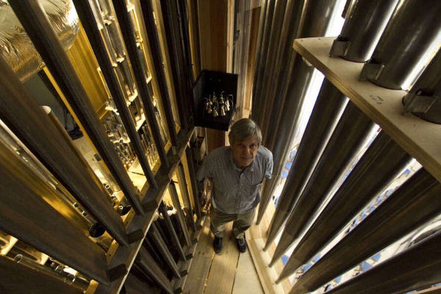 Pasi Organ Builders' Martin Pasi stands inside the new pipe organ at the Co-Cathedral.