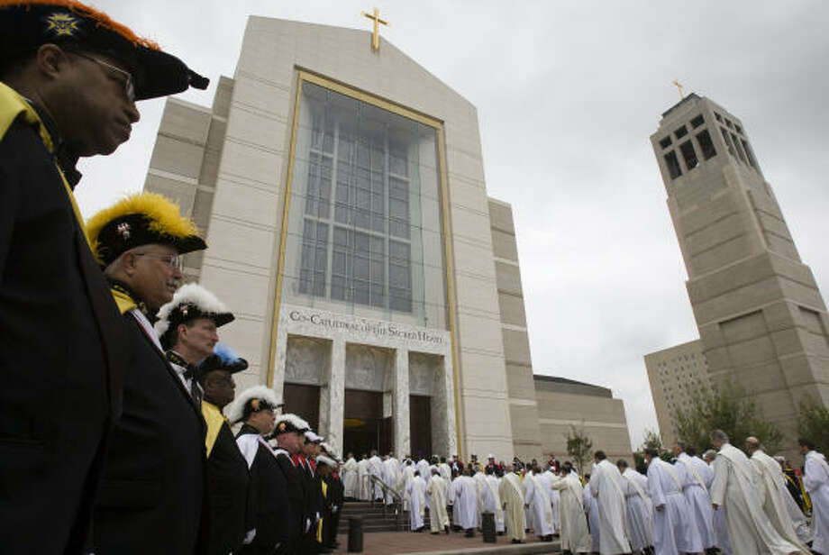 Priests and deacons enter the new building in a procession at the beginning of the dedication of the Co-Cathedral of the Sacred Heart Wednesday, April 2, in Houston. Photo: Smiley N. Pool, Chronicle