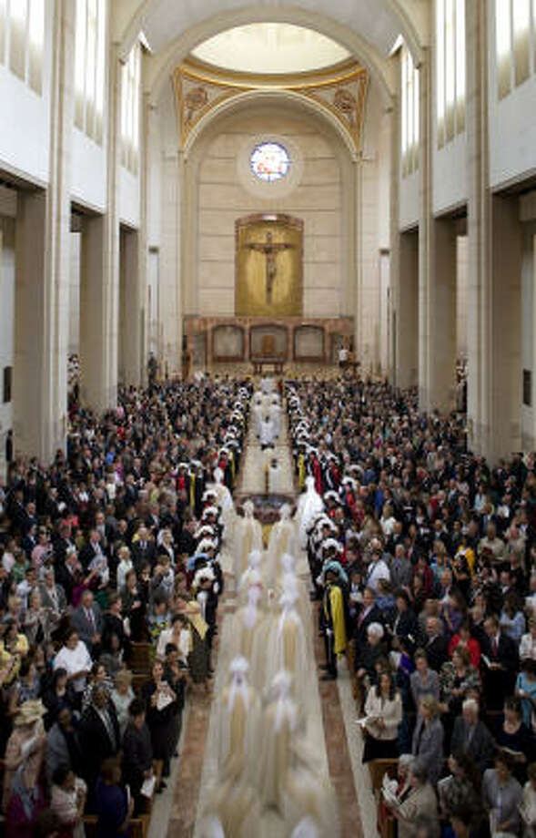 Bishops enter the new co-cathedral near the end of Wednesday's procession. Photo: Smiley N. Pool, Chronicle