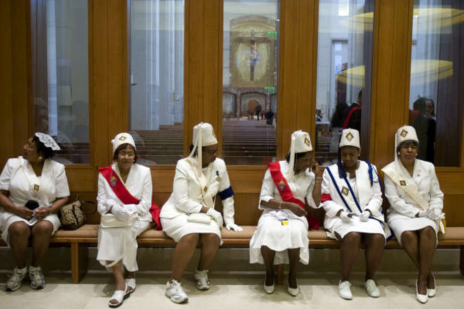 Members of the Knights of Peter Claver Ladies Auxiliary wait to greet guests before the doors open for the dedication. Photo: Smiley N. Pool, Chronicle