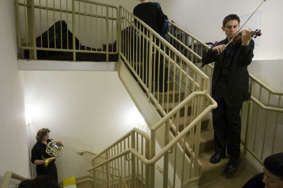Orchestra members warm up in a stairwell before the dedication. Photo: Smiley N. Pool, Chronicle