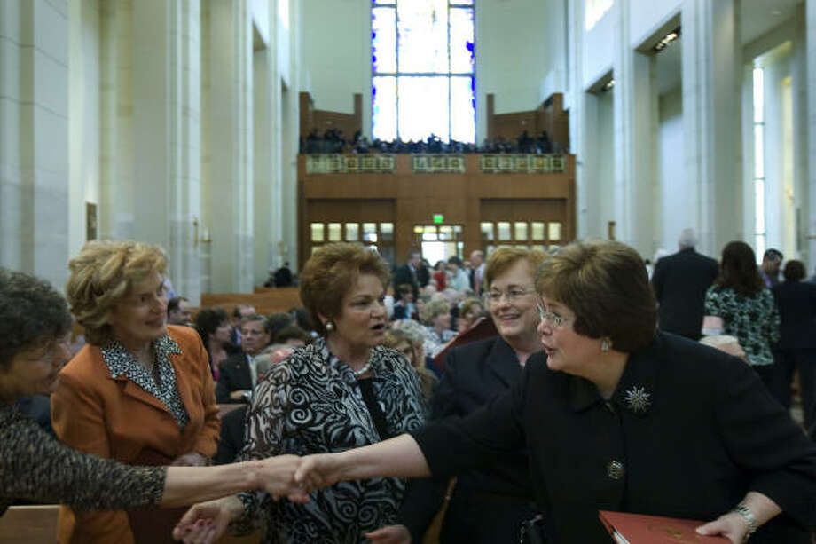 Cardinal Daniel DiNardo's twin sister, Peg Riesmeyer, right, greets other guests as she arrives for the dedication. Photo: Smiley N. Pool, Chronicle