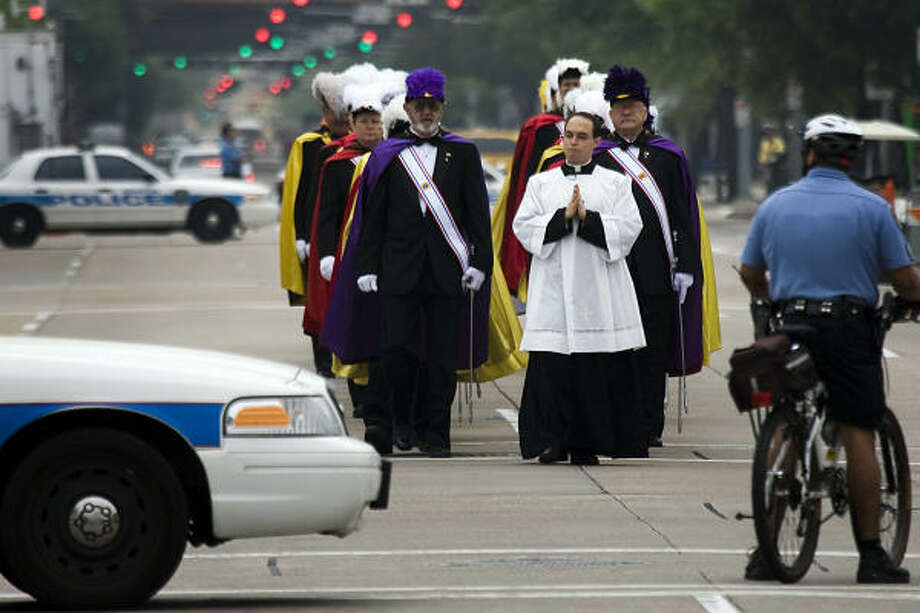 Members of the Knights of Columbus walk to the new Sacred Heart Co-Cathedral as police block traffic. Photo: Smiley N. Pool, Chronicle