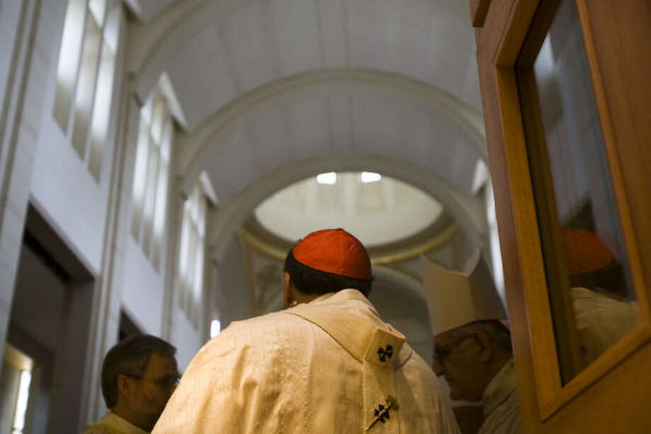 The Rev. R. Troy Gately, from left, Cardinal Daniel N. DiNardo and Archbishop Emeritus Joseph Fiorenza at the interior door of the co-cathedral. Photo: Smiley N. Pool, Chronicle
