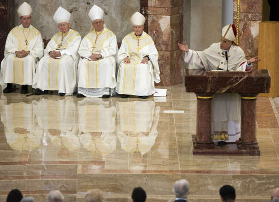 Cardinals Roger Mahony of Los Angeles, from left, William H. Keeler of Baltimore, Adam Maida of Detroit and Theodore McCarrick  of Washington, D.C., listen to the homily of Cardinal Daniel N. DiNardo of the Archdiocese of Galveston-Houston. Photo: Smiley N. Pool, Chronicle