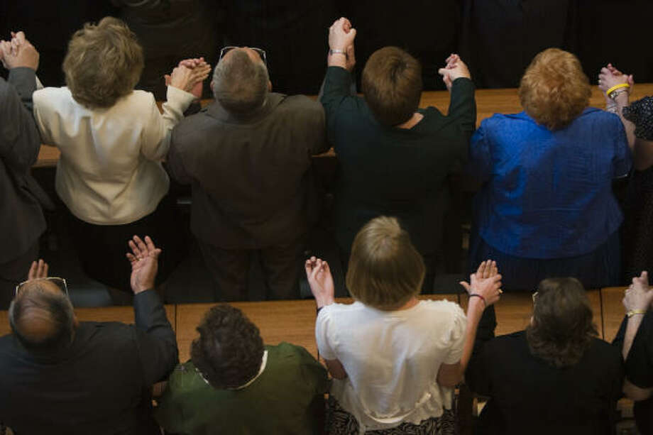 Worshippers pray during the dedication. Photo: Smiley N. Pool, Chronicle
