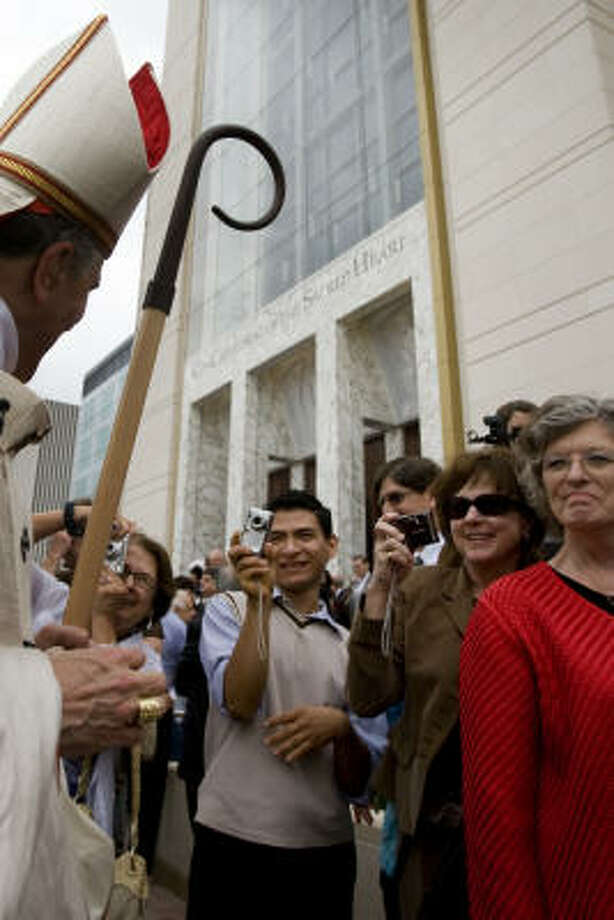 Cardinal Daniel N. DiNardo greets the crowd outside the co-cathedral after the ceremony. Photo: Smiley N. Pool, Chronicle
