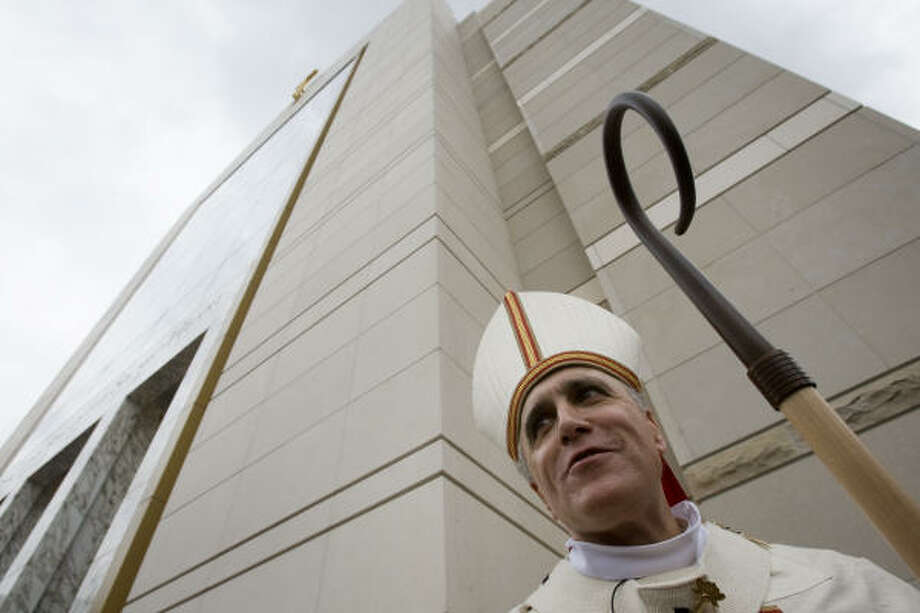 Cardinal Daniel N. DiNardo speaks to reporters after the dedication. Photo: Smiley N. Pool, Chronicle