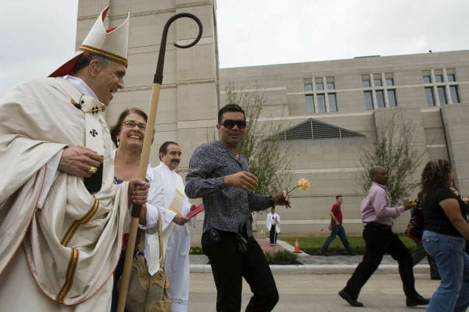 Cardinal Daniel N. DiNardo is congratulated by onlookers following the dedication. Photo: Smiley N. Pool, Chronicle