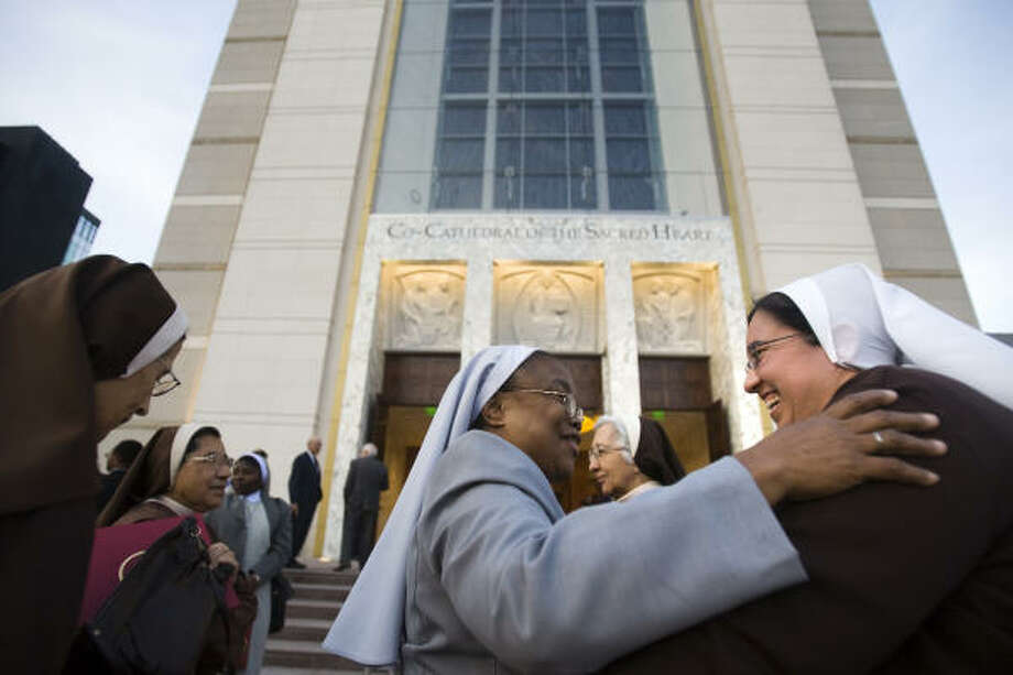 A group of nuns embrace following First Vespers at the Sacred Heart Co-Cathedral. Photo: Smiley N. Pool, Chronicle