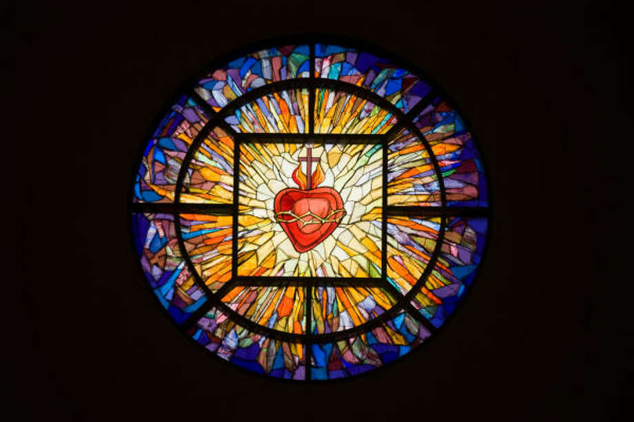 The east window above the marble statue of Jesus in the Sacred Heart Shrine symbolizes the sacred heart. Photo: Smiley N. Pool, Chronicle