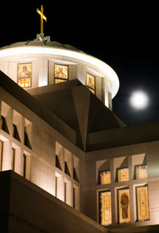 A full moon rises behind the dome on top of the Co-Cathedral of the Sacred Heart. Photo: Smiley N. Pool, Chronicle