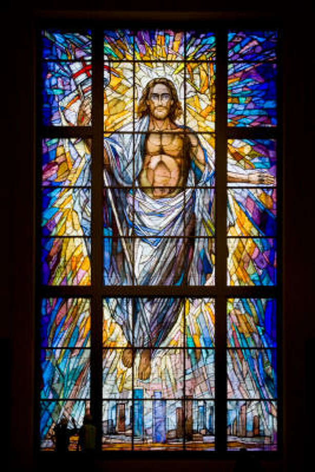 The tiny figures of two workers can barely be seen at bottom left against the massive Resurrection Window. The 40-foot-tall, 20-foot-wide stained-glass window is on the facade of the co-cathedral. Photo: Smiley N. Pool, Chronicle