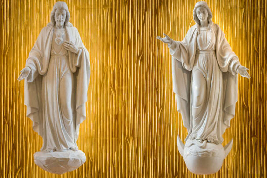 Two photos presented side by side show the statue of the Sacred Heart of Jesus, left, and the Immaculate Conception of Mary. Photo: Smiley N. Pool, Chronicle