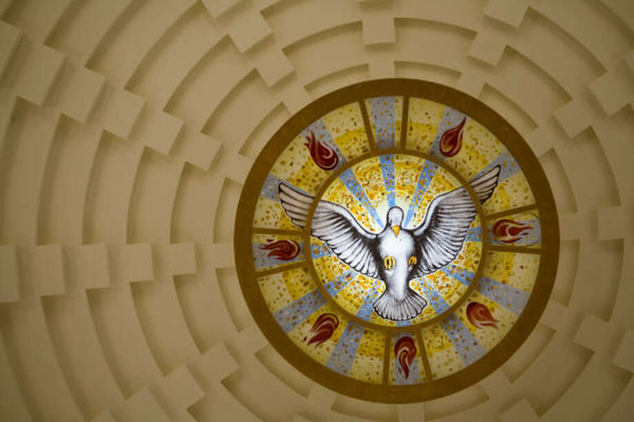 The colored glass oculus, or eye window in the top of the dome, depicts a dove that represents the Holy Spirit. Photo: Smiley N. Pool, Chronicle