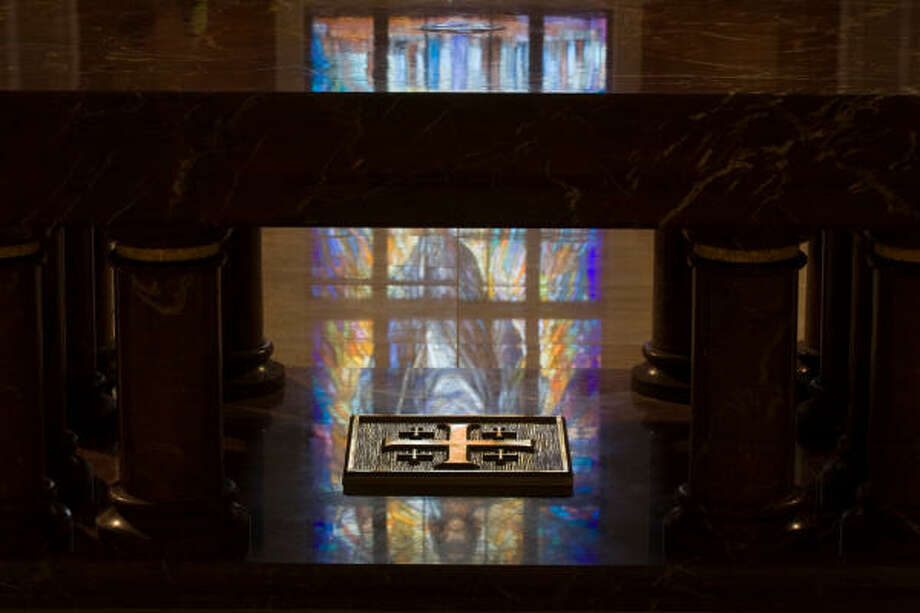 The Resurrection Window is reflected on the altar and the reliquary in its base. Photo: Smiley N. Pool, Chronicle