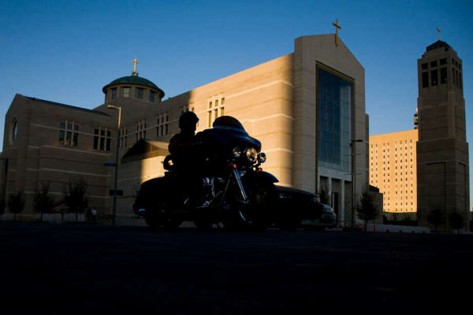 Traffic on Fannin passes the Co-Cathedral of the Sacred Heart downtown. Photo: Smiley N. Pool, Chronicle
