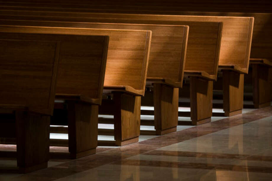 Sunlight spills across pews. The co-cathedral can seat 1,820 people in pews and can accommodate an additional 200 in chairs. Photo: Smiley N. Pool, Chronicle