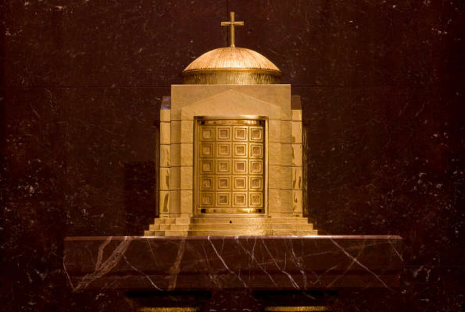 The Eucharistic Shrine to the left of the altar features a golden tabernacle that echoes the shape of the co-cathedral. It is used to store consecrated communion wafers. Photo: Smiley N. Pool, Chronicle