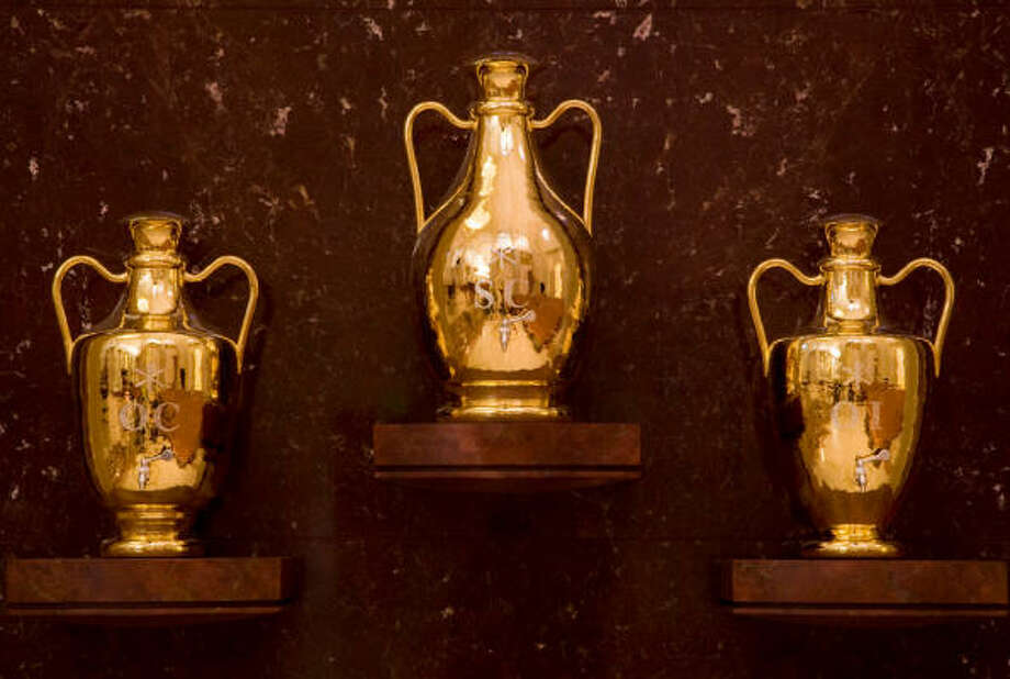 Three large silver urns with gold finish for Holy oils. Photo: Smiley N. Pool, Chronicle