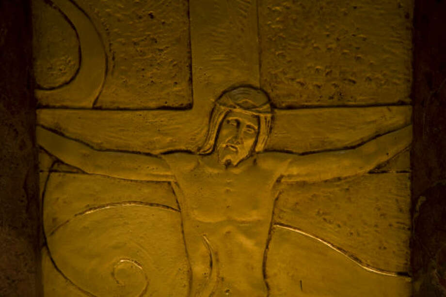 One of eight eight gold-plated bronze images from the Bible is seen on the Baptismal Font. Photo: Smiley N. Pool, Chronicle