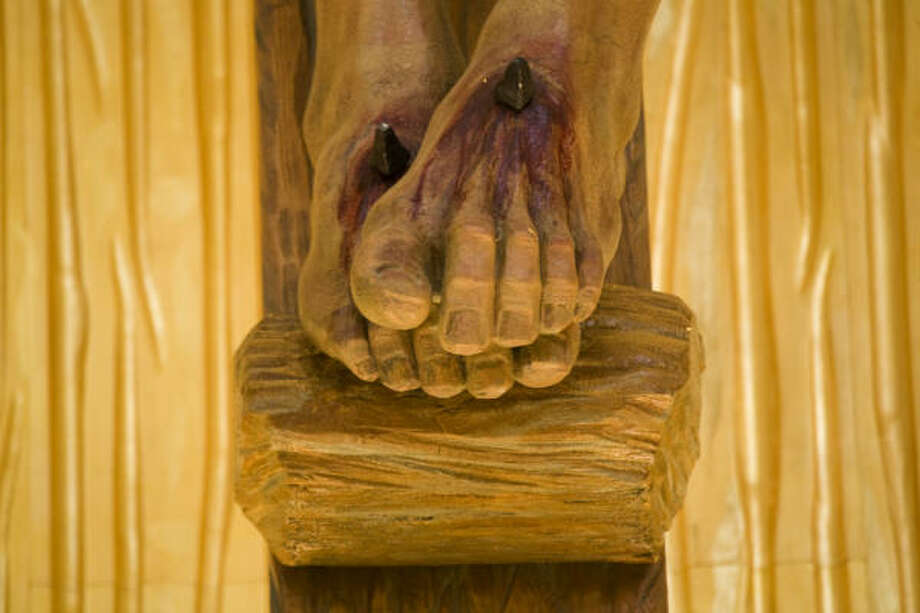 The feet of Jesus on the crucifix. Photo: Smiley N. Pool, Chronicle