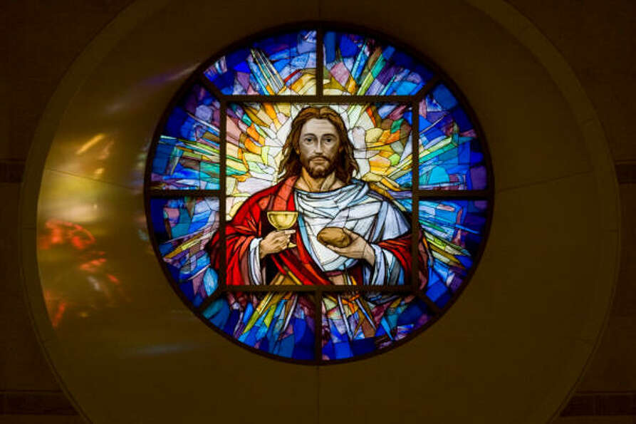 The Rose Window above the altar depicts Jesus with bread and wine.