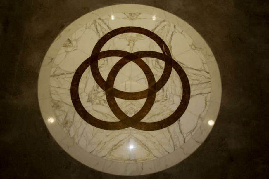 Interlocking rings on the floor of the co-cathedral entryway symbolize the Holy Trinity. Photo: Smiley N. Pool, Chronicle