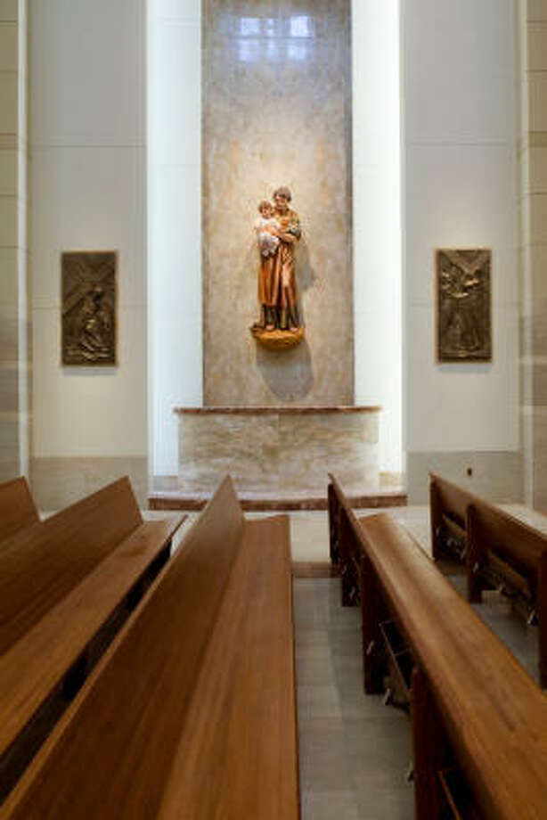 The new co-cathedral includes six shrines along the walls of the nave. Each has an 8-foot tall linden wood sculpture of a saint carved by Edmund Rabanser in Italy. Photo: Smiley N. Pool, Chronicle