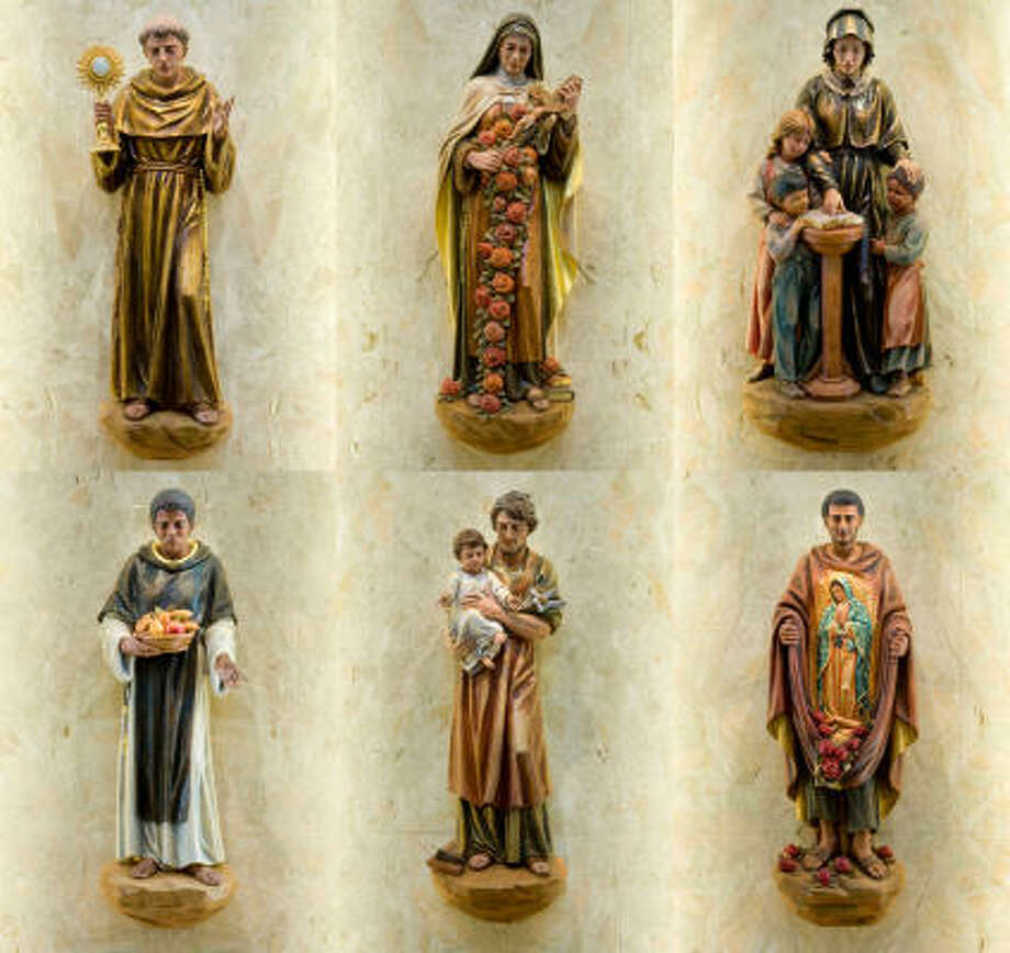 The saints in the nave shrines, shown top row from from left:  St. Anthony of Padua, St. Therese of Lisieux and St. Elizabeth Ann Seton.  Bottom row from left: A statue St. Martin de Porres, St. Joseph and St. Juan Diego. Photo: Smiley N. Pool, Chronicle