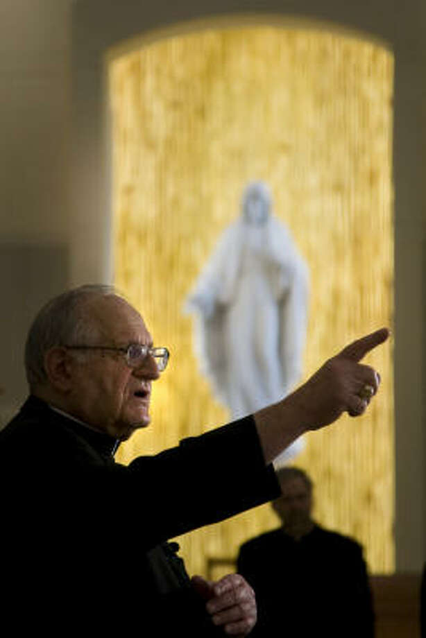 Archbishop Emeritus Joesph Fiorenza points out features of the building during a preview tour. Photo: Smiley N. Pool, Chronicle