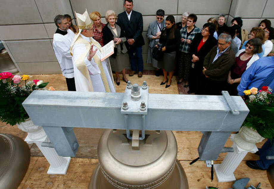 Archbishop Emeritus Joseph A. Fiorenza blessed bells in December for the bell tower next to the Co-Cathedral of the Sacred Heart. Photo: Steve Ueckert, Chronicle