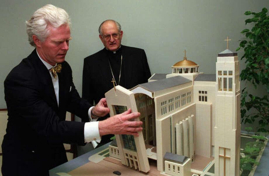 R. Scott Ziegler of Ziegler Cooper Architects shows Archbishop Emeritus Joseph A. Fiorenza a model of the Co-Cathedral of the Sacred Heart. Ziegler's company designed the building. Photo: Steve Campbell, Chronicle