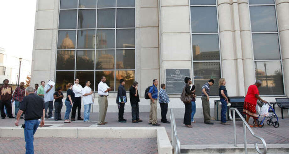 The morning line outside the Harris County Criminal Justice Center forms last week. Photo: Melissa Phillip, Chronicle