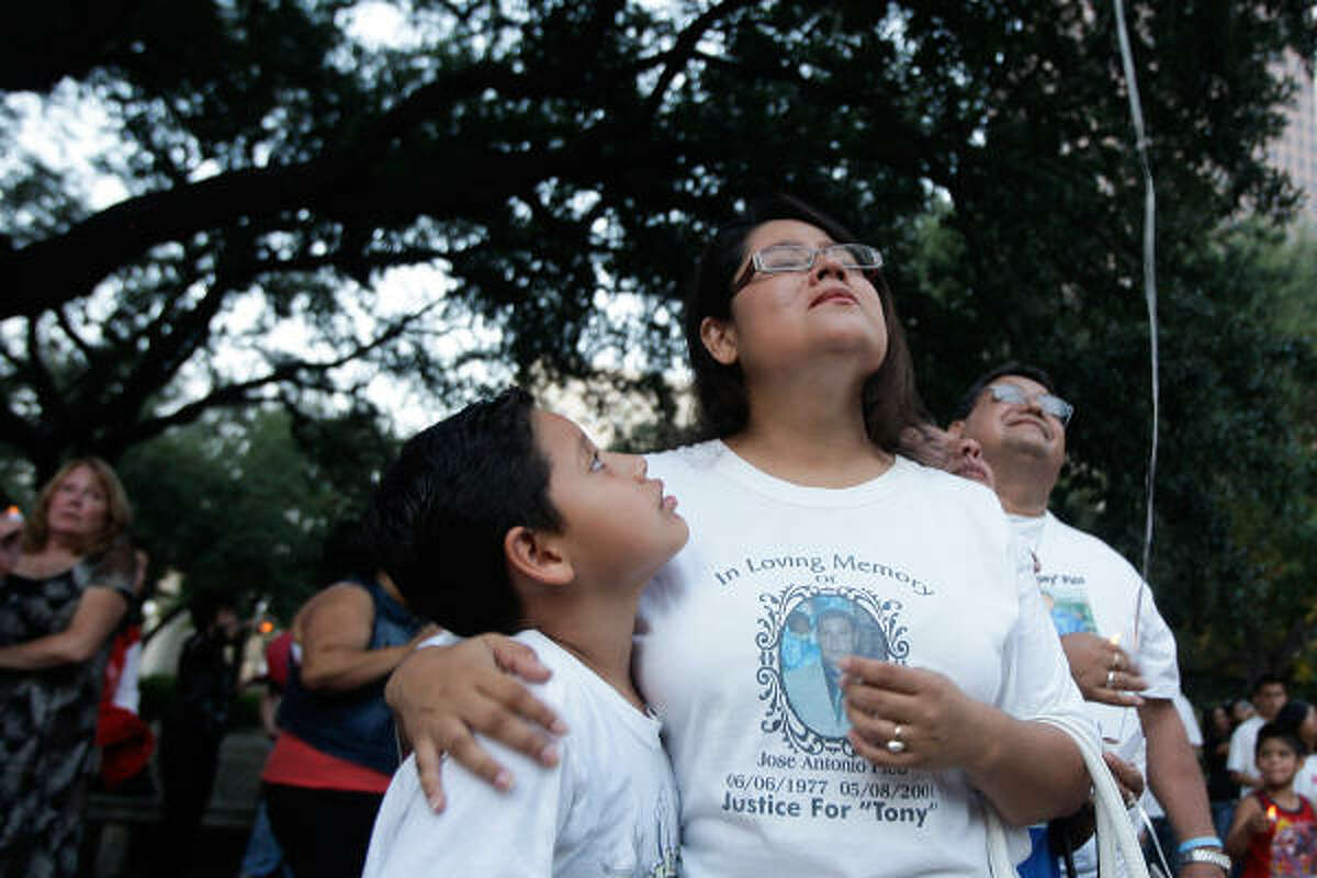 Helen Pico and her son Fabian watch as they release a balloon in remembrance of her brother Jose Pico who was murdered in May of 2001 as the Houston Chapter of Parents of Murdered Children hold a candlelight vigil to recognize the National Day of Remembrance at Houston City Hall.