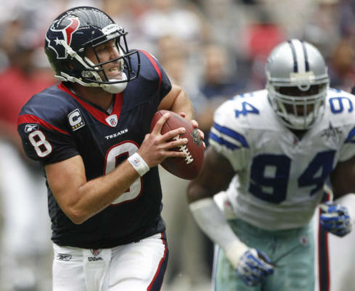 Sept. 26: Cowboys 27, Texans 13 Texans quarterback Matt Schaub (8) is chased out of the pocket by Cowboys linebacker DeMarcus Ware. Ware sacked Schaub three times.