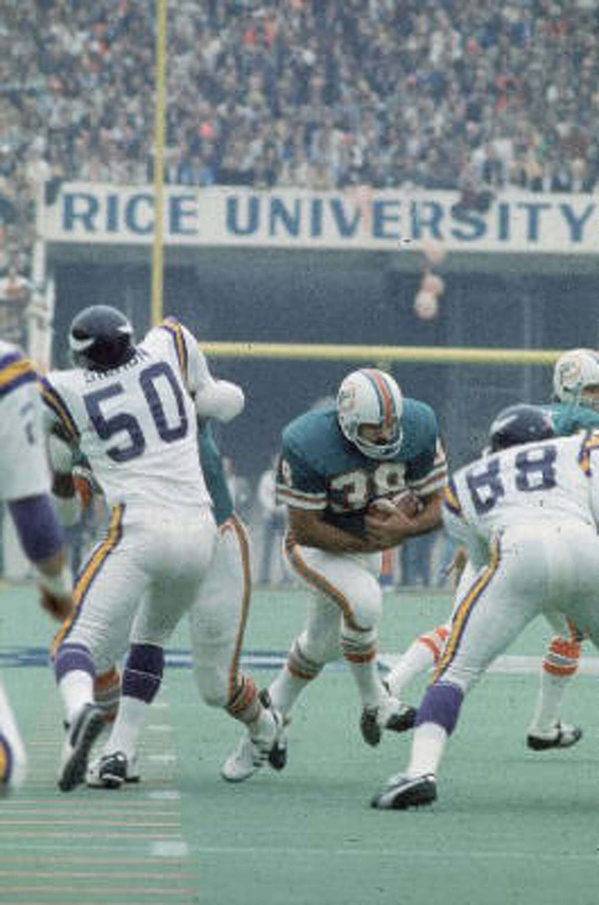 Miami Dolphins running back Larry Csonka (39) rushed for a then-Super Bowl record 145 yards and was named the game's MVP.
