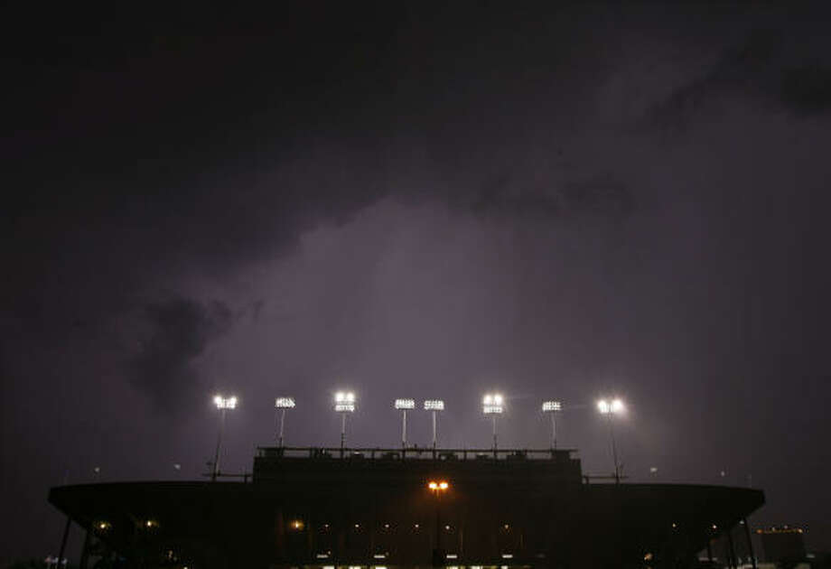 Lightning illuminates the sky over Rice Stadium during a delay at the Owls' game against Nicholls State on Sept. 1, 2007. Photo: James Nielsen, Houston Chronicle